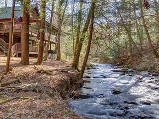 Rustic & ready creekside cabin w/ a private hot tub, shared pool, & tennis