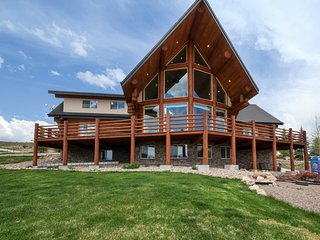 Elegantly-furnished lodge w/ a large, furnished deck, lake views, & much more!