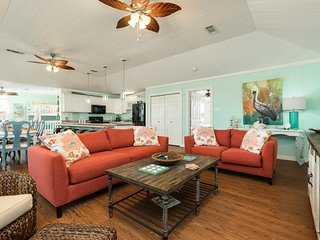 Beautiful waterfront home w/ deck, patio - walking distance to beach - dogs OK!