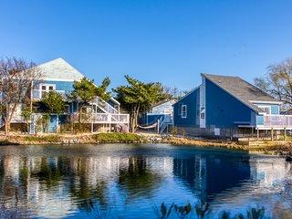 Three-building, waterfront property w/ bay views, decks, & full kitchens