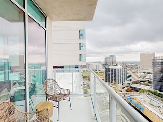 Stunning high-rise condos w/ shared infinity pool, fitness center, & pool table!
