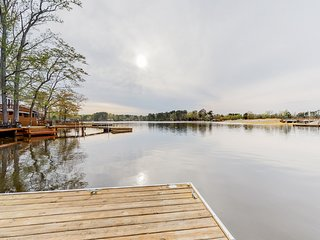 Dog-friendly waterfront home w/ a large patio and a gas grill