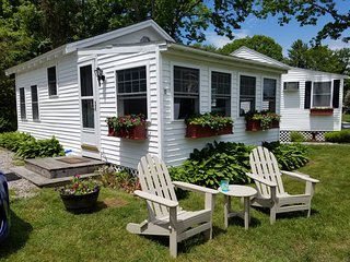 NEW LISTING! Cottage w/chairs to relax in front and shared sun deck and pool
