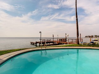 Bayfront condo w/ shared pool & private boat slip - close to beach!