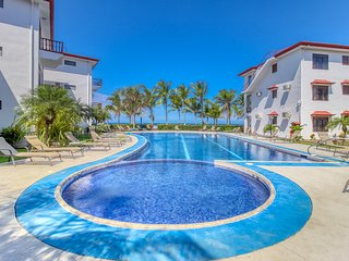 Elegant oceanfront condo w/ ocean views & shared pool - steps from the beach!