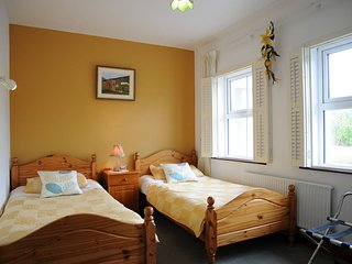Twin Room with private bathroom. Down stairs room. Free WiFi.