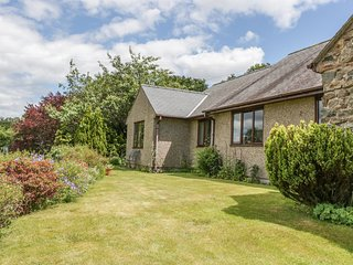 LLETY NEST, single-storey cottage on farm, wonderful views, close to walks and
