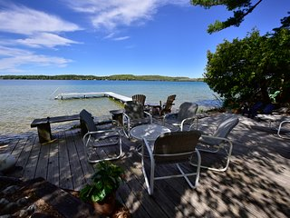 153 foot of private NORTH Lake Leelanau frontage, with swim raft and paddle boat
