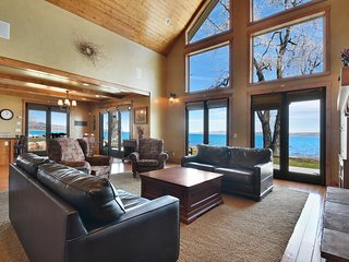 Lakefront home w/ a large deck, great views, firepit, & two fireplaces!