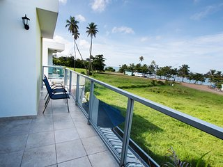 Beachfront townhouse in gated community w/patio, balcony & pool, close to all.