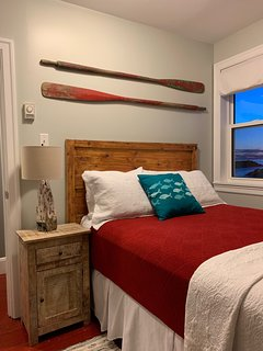upstairs bedroom with red  accents