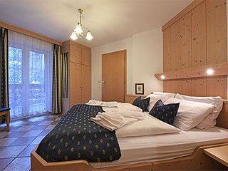 Residence Amadeus.Accurato appartamento da 4 persone arredato in legno massiccio