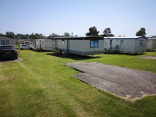 Large 2 bed caravan, separate dining & lounge area. FREE parking near caravan