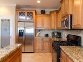 Full kitchen with gas stove and granite counters