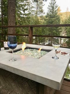 Outdoor gas fire pit overlooking the river
