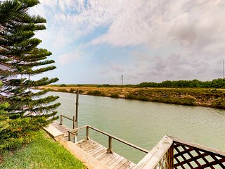 Bayfront cottage w/ porch, canal view & shared pools/hot tub/gym - 2 dogs OK!