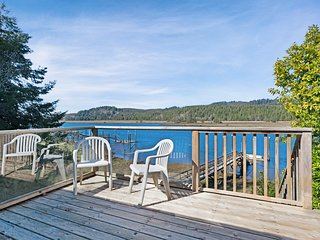 Waterfront cabin-style home with a private dock & furnished deck!