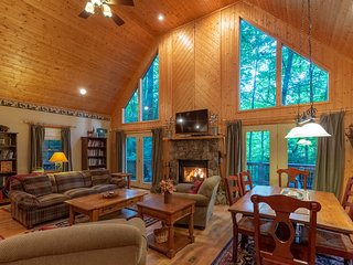 Modern cabin w/ firepit, hot tub & wrap-around porch - cathedral ceiling!