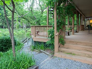 Pet-friendly riverfront home w/ two decks, fireplace & enclosed porches!