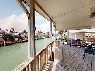 Charming canal-front home w/ dock & shared pools/hot tub/tennis - 2 dogs OK