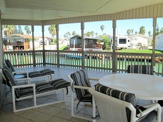 Waterfront home w/ dock, wrap-around deck & shared pools/hot tub - 2 dogs OK!