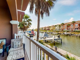 Charming, waterfront townhouse w/ shared pools, hot tub, dock, & gym!