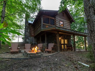 Log home in private neighborhood with covered porch & fireplace