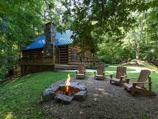 Log cabin in private community with stone fireplace & wrap-around porch