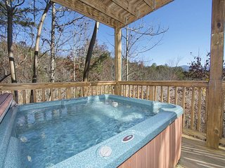 Family cabin w/ private hot tub, pool table & shared pool/hot tub/fishing dock!
