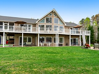 Lakefront home w/ private beach, covered dock, outdoor kitchen & fire pit!