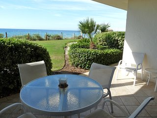 Gulf front condo with shared swimming pool & private ground floor patio