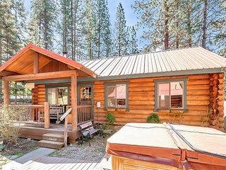Riverfront, dog-friendly cabin w/ hot tub, BBQ station & stunning views!
