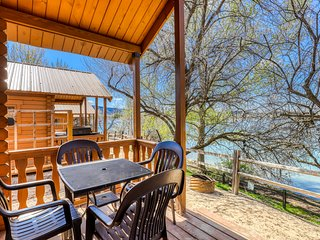 Dog-friendly, dry cabin right on the lake w/ a cozy porch & gas grill