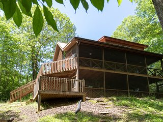 Creekside cabin w/ wood-burning fireplace, pool table, & outdoor fire pit!