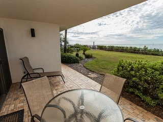 Ground floor waterfront condo w/ shared pool & furnished patio