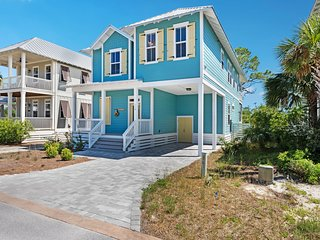 Elegant coastal home w/ ample porch space & shared pool - walk to beach!