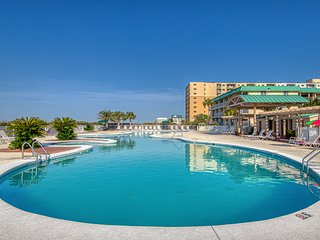 Hotel condo features beach access, shared pool/hot tub, near town