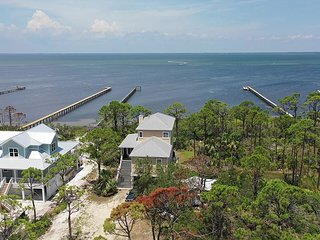 New Listing!  Amazing executive bay front home with 500' dock, beach gear.