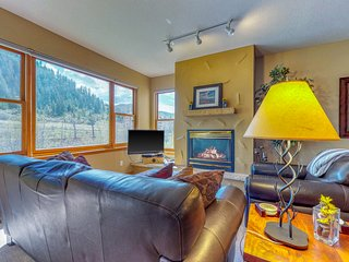 Ski-in/ski-out waterfront townhome w/ shared hot tub & balcony
