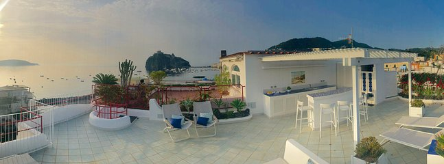 Panoramic Rooftop overlooking the Aragonese Castle and the Costa dei Ciclopi