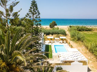 Mavi Beachfront Villa with heated pool, walking distance to everything!