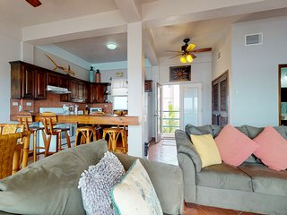 Sunny, lagoon-front condo w/ shared pool, private balcony, & water views