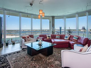 Contemporary Penthouse Condominium with Theater-Style Chairs & TV in Media Room