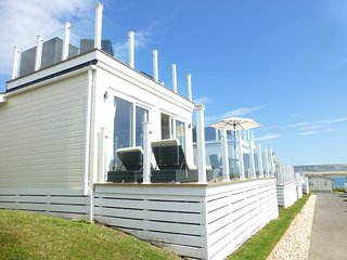 Superb holiday lodge with sea views.