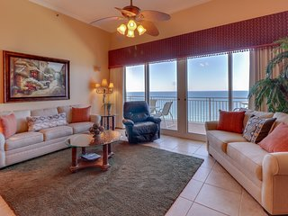 Beach view condo with large balcony and shared pool/hot tub