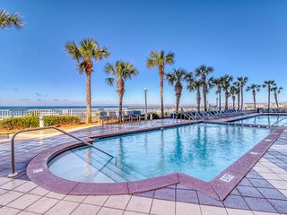 Tropical, waterfront condo w/ shared pool & beach access plus a private balcony
