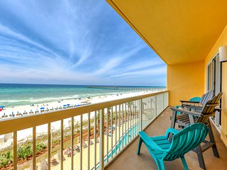 Waterfront getaway w/ a full kitchen, furnished balcony, shared pool, & gym