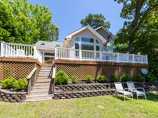 Waterfront home w/ garage, dock, decks, shared pools, & tennis courts
