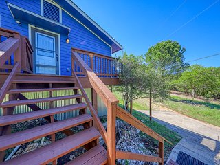 NEW LISTING! Cozy country home on nine wooded acres w/ a wraparound deck