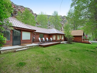 Cozy waterfront cabin w/ a furnished, wraparound deck, firepit, & gas grill